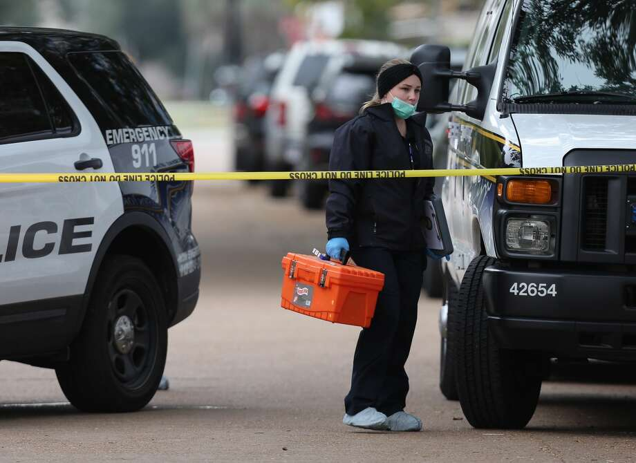HPD and Houston Forensic Science Center officials investigate the scene where a drive-by shooting left one Lamar High School student dead near Bammel Lane and Philfall Street on Tuesday, Nov. 13, 2018, in Houston. >>Here are more unsolved homicides of the past year... Photo: Yi-Chin Lee /Staff Photographer