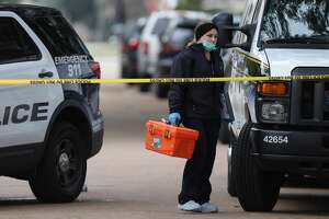 HPD and Houston Forensic Science Center officials investigate the scene where a drive-by shooting left one Lamar High School student died near the intersection of Bammel Lane and Philfall Street on Tuesday, Nov. 13, 2018, in Houston.