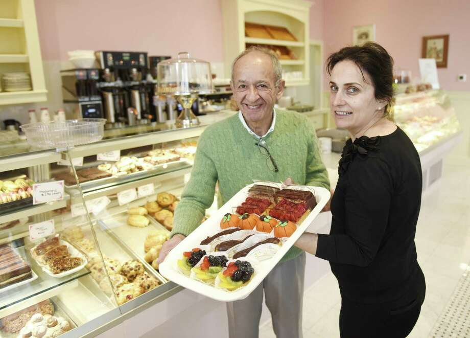 Owner Par Shakiban and Manager Kelly Murati show a colorful array of baked goods at the new Patisserie Salzburg at 10 Harbor Point Road, in the Harbor Point neighborhood, of Stamford, Conn., on Tuesday, Nov. 13, 2018. The new bakery-cafe features a variety of baked goods, as well as coffee and soups, salads and sandwiches. Photo: Tyler Sizemore / Hearst Connecticut Media / Greenwich Time