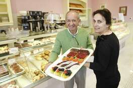 Owner Par Shakiban and Manager Kelly Murati show a colorful array of baked goods at the new Patisserie Salzburg at 10 Harbor Point Road, in the Harbor Point neighborhood, of Stamford, Conn., on Tuesday, Nov. 13, 2018. The new bakery-cafe features a variety of baked goods, as well as coffee and soups, salads and sandwiches.