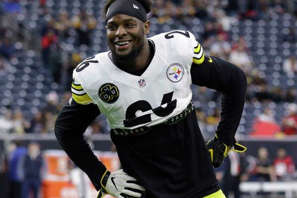 FILE - In this Dec. 25, 2017, file photo, Pittsburgh Steelers running back Le'Veon Bell (26) warms up before an NFL football game against the Houston Texans, in Houston. The Le'Veon Bell watch is almost over for the Steelers. The star running back has until 4 p.m. on Tuesday, Nov. 13, 2018, afternoon to sign his one-year franchise tender and be eligible to play this season.