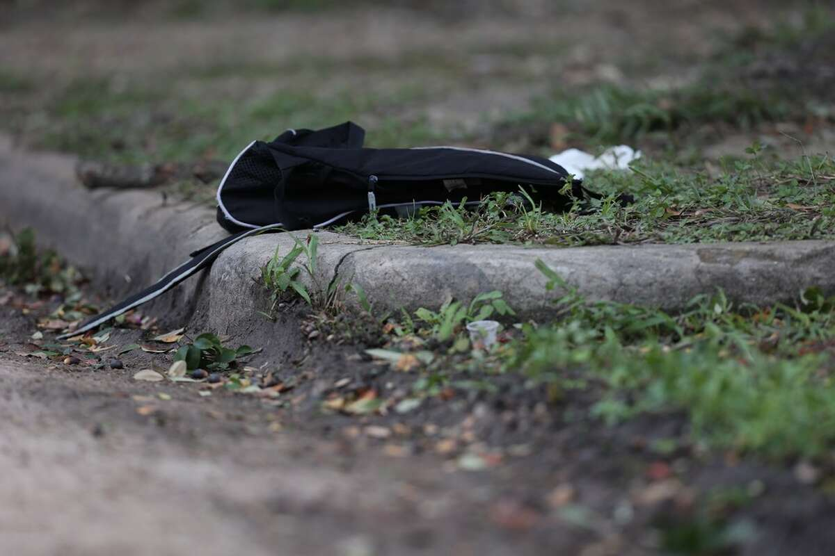A black backpack is left at the scene where a shooting left one Lamar High School student dead near the intersection of Bammel Lane and Philfall Street on Tuesday, Nov. 13, 2018, in Houston.