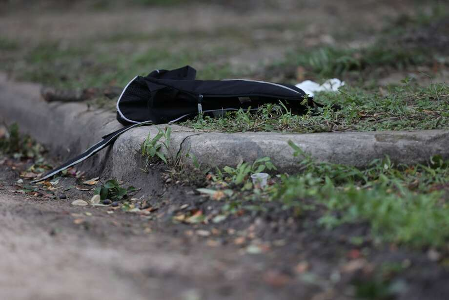 A black backpack is left at the scene where a shooting left one Lamar High School student dead near the intersection of Bammel Lane and Philfall Street on Tuesday, Nov. 13, 2018, in Houston. Photo: Yi-Chin Lee / Houston Chronicle