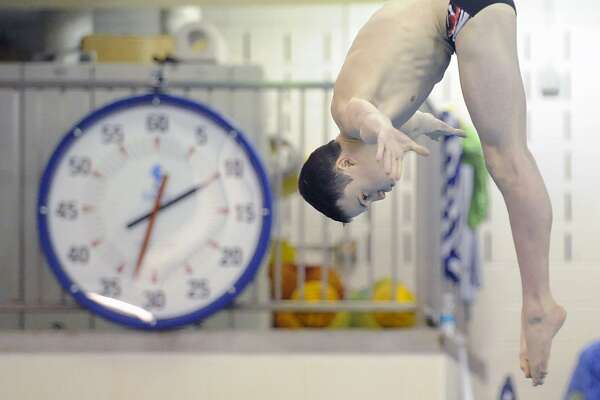 Westhill-Stamford diver Sean Burston competes against Greenwich High School on Feb. 4, 2012.