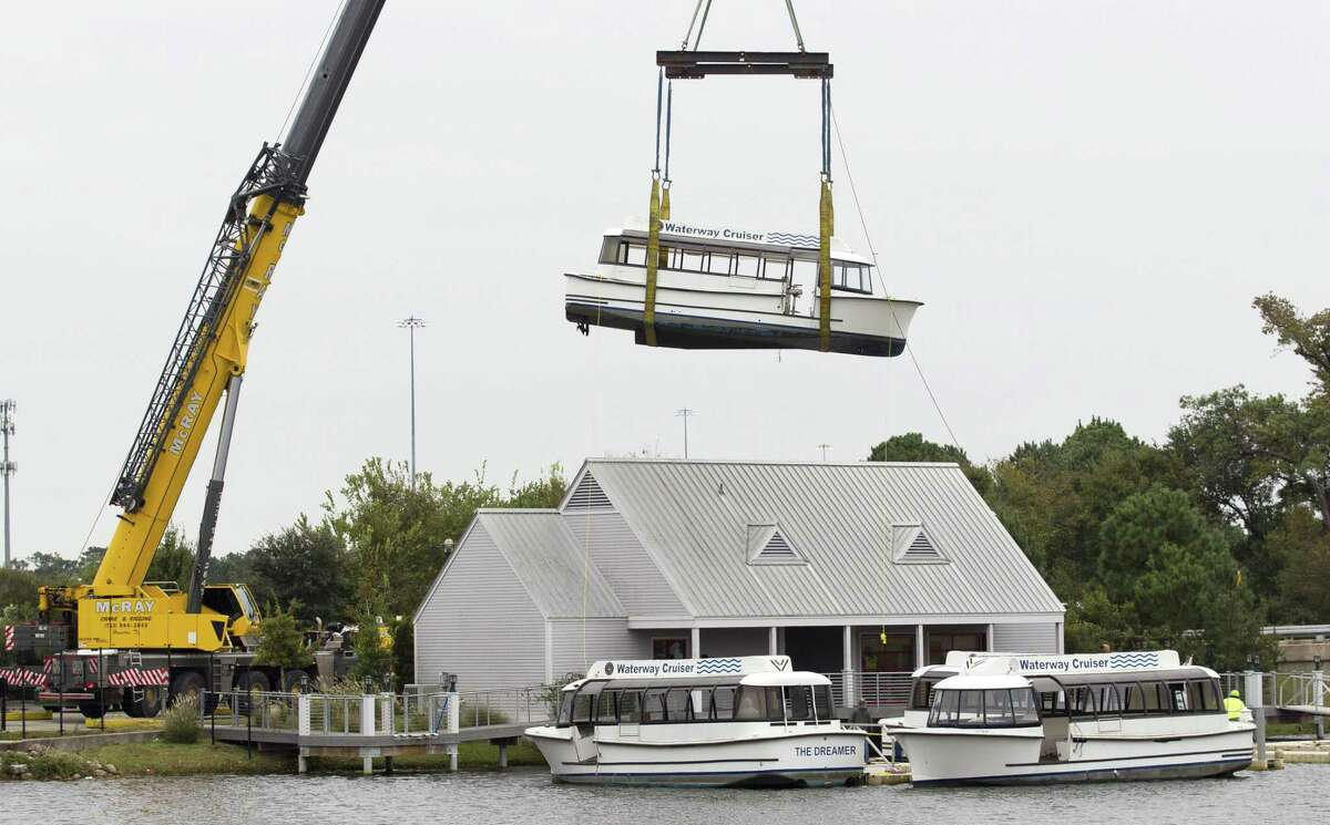 The Woodlands Waterway Cruisers are removed from their dock in front of The Woodlands Mall along I-45, Tuesday, Nov. 13, 2018, in The Woodlands. The board of Visit The Woodlands Texas, formerly The Woodlands Convention and Visitors Bureau, unanimously approved the disposal of the six cruisers in August. The boats were heavily damaged during Hurricane Harvey in 2017 and haven?'t been in operation since February 2018.