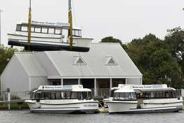 The Woodlands Waterway Cruisers are removed from their dock in front of The Woodlands Mall along I-45, Tuesday, Nov. 13, 2018, in The Woodlands. The board of Visit The Woodlands Texas, formerly The Woodlands Convention and Visitors Bureau, unanimously approved the disposal of the six cruisers in August. The boats were heavily damaged during Hurricane Harvey in 2017 and haven?•t been in operation since February 2018.