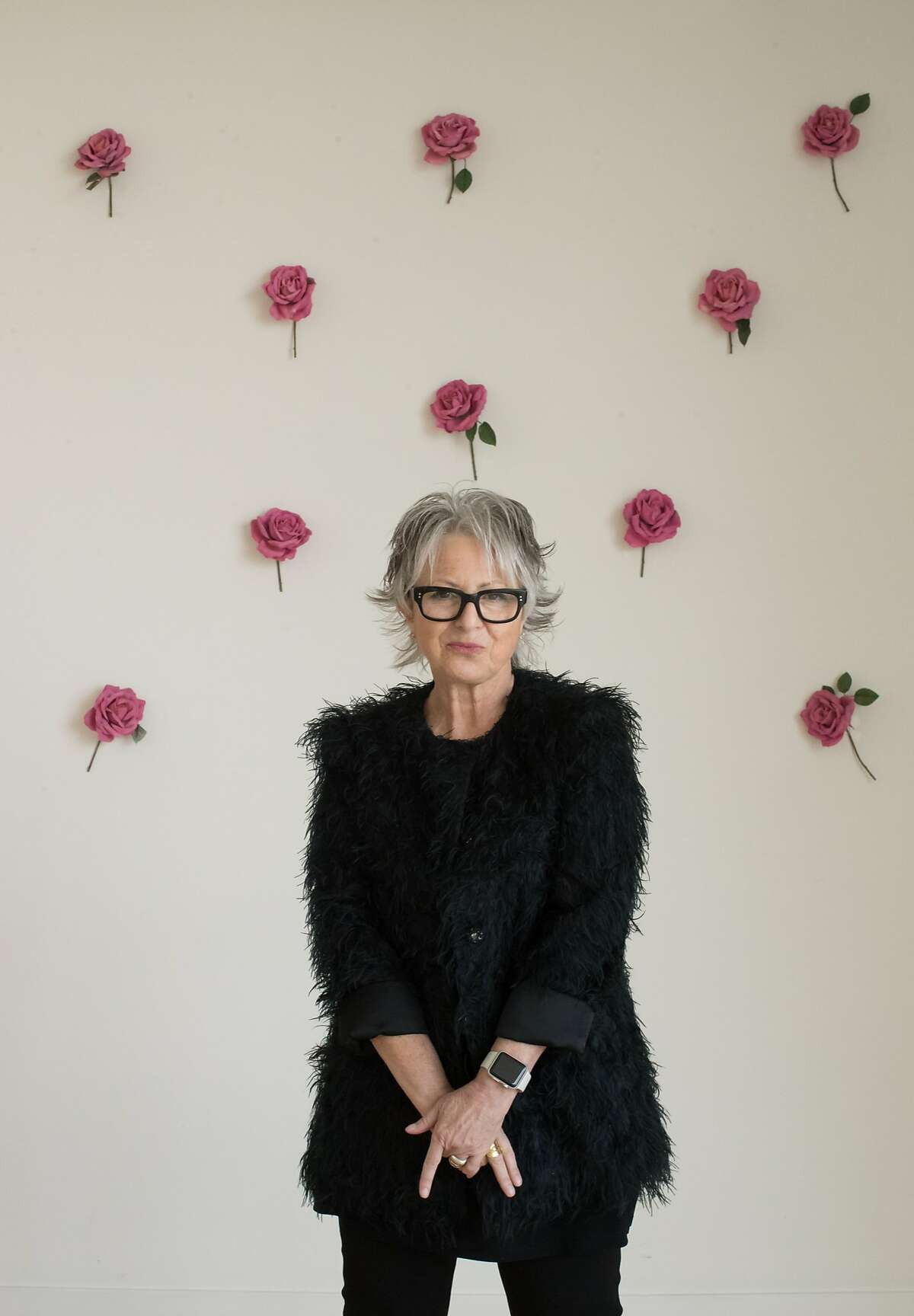Jennifer Morla, creative director, graphic designer and founder at her home with roses on her wall she had up since 1995 on Monday, Nov. 12, 2018, in San Francisco, Calif.