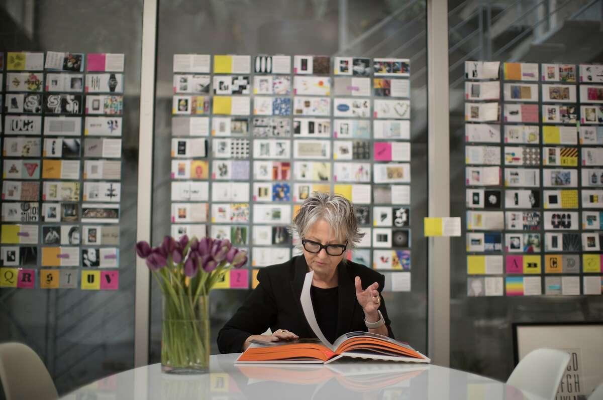 Jennifer Morla, creative director, graphic designer in her studio with her book's comprehensives taped behind her on Monday, Nov. 12, 2018, in San Francisco, Calif.