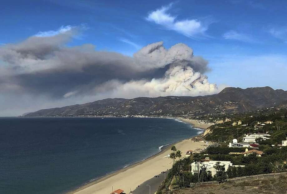 A large plume of smoke from a wildfire near Lake Sherwood can be seen from Malibu, Calif. on Tuesday, Nov. 13, 2018.(AP Photo/Brian Skoloff) Photo: Brian Skoloff / Associated Press