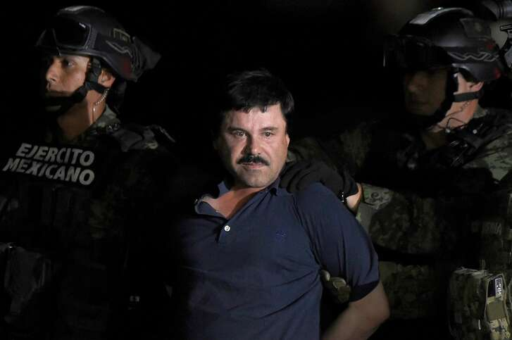 "(FILES) In this file photo taken on January 8, 2016 Drug kingpin Joaquin ""El Chapo"" Guzman is escorted into a helicopter at Mexico City's airport following his recapture during an intense military operation in Los Mochis, in Sinaloa State. - Prosecutors and defense lawyers are set to deliver opening statements on November 13, 2018 in the New York trial of Joaquin ""El Chapo"" Guzman, one of the world's most notorious criminals accused of spending a quarter of a century smuggling cocaine into the United States. (Photo by ALFREDO ESTRELLA / AFP)ALFREDO ESTRELLA/AFP/Getty Images"