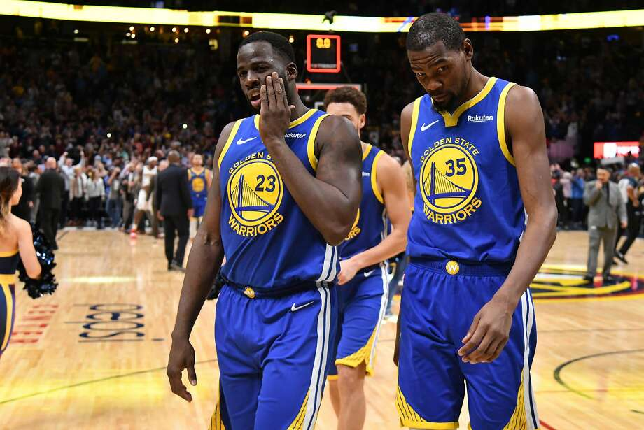 eea57b0ef773 Draymond Green  23 and Kevin Durant  35 of the Golden State Warriors walk  off