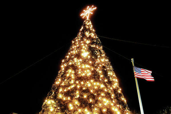 The Alton Christmas tree glows in the cold and windy night after being lit for the 2016 holiday season.