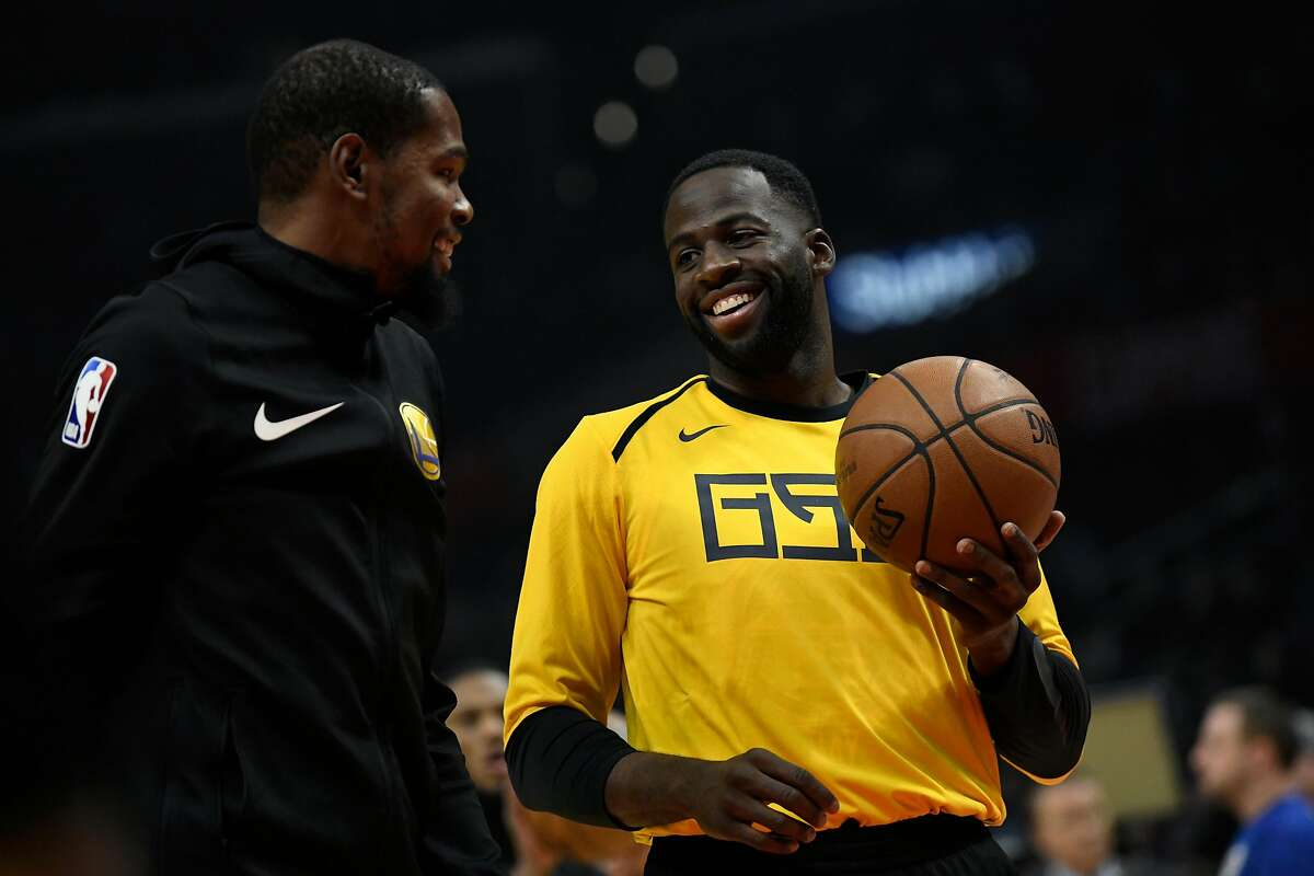 LOS ANGELES, CA - NOVEMBER 12: Kevin Durant #35 of the Golden State Warriors talks to his teamate Draymond Green during warm up before the game against the Los Angeles Clippers on November 12, 2018 at STAPLES Center in Los Angeles, California. NOTE TO US