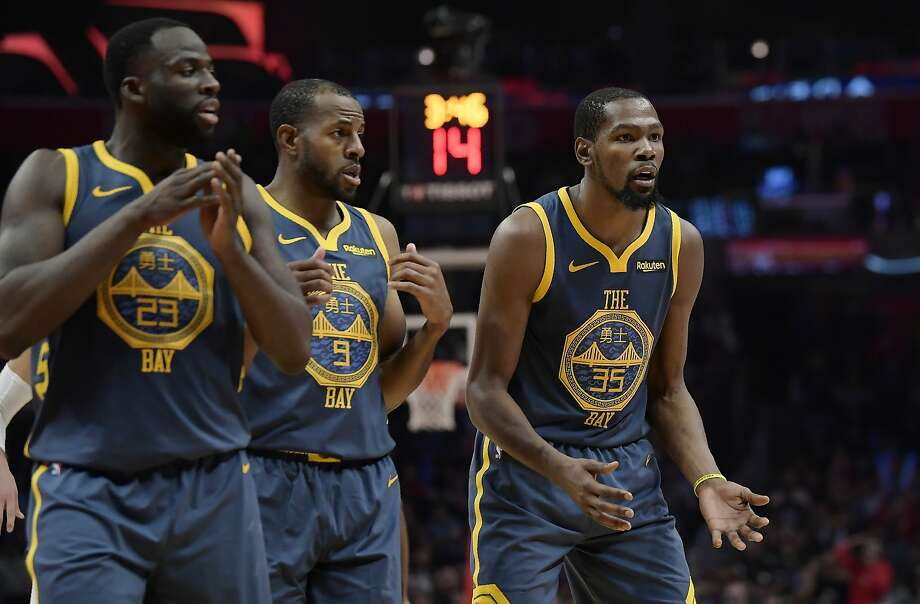 FILE – Golden State Warriors forward Kevin Durant, right, reacts as he fouls out of the game while forward Draymond Green, left, and guard Andre Iguodala look on during the overtime portion of an NBA basketball game against the Los Angeles Clippers in Los Angeles in this Nov. 12, 2018 file photo. Iguodala and Durant went back and forth on Twitter on Wednesday over a memory Iguodala shared about Durant getting mad when double-teamed by him and Green at a Warriors practice. Photo: Mark J. Terrill, Associated Press