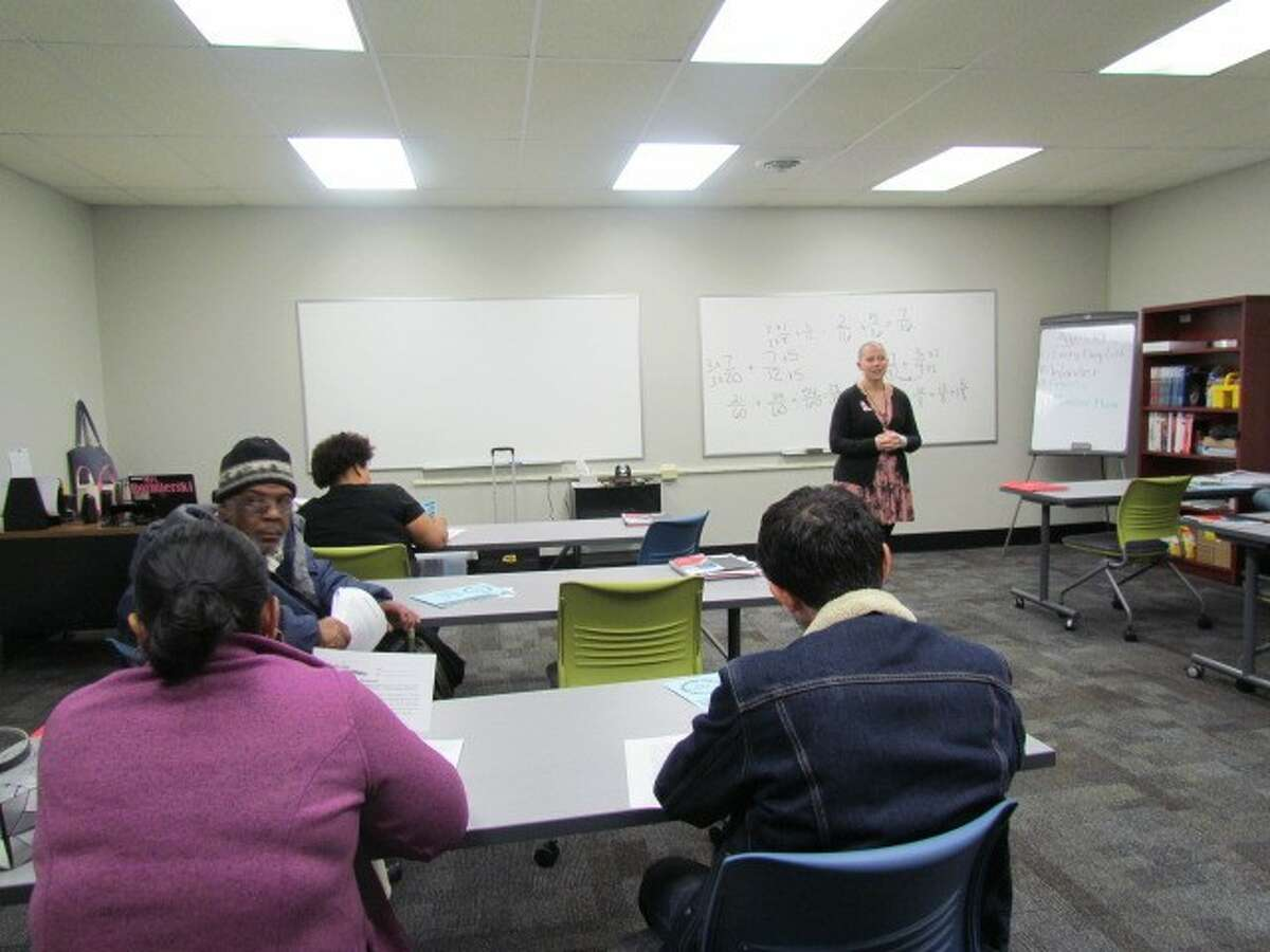 Tteacher Heather Rozmierski instructing students at the Literacy Zone in Arbor Hill. (credit: Donna Liquori)