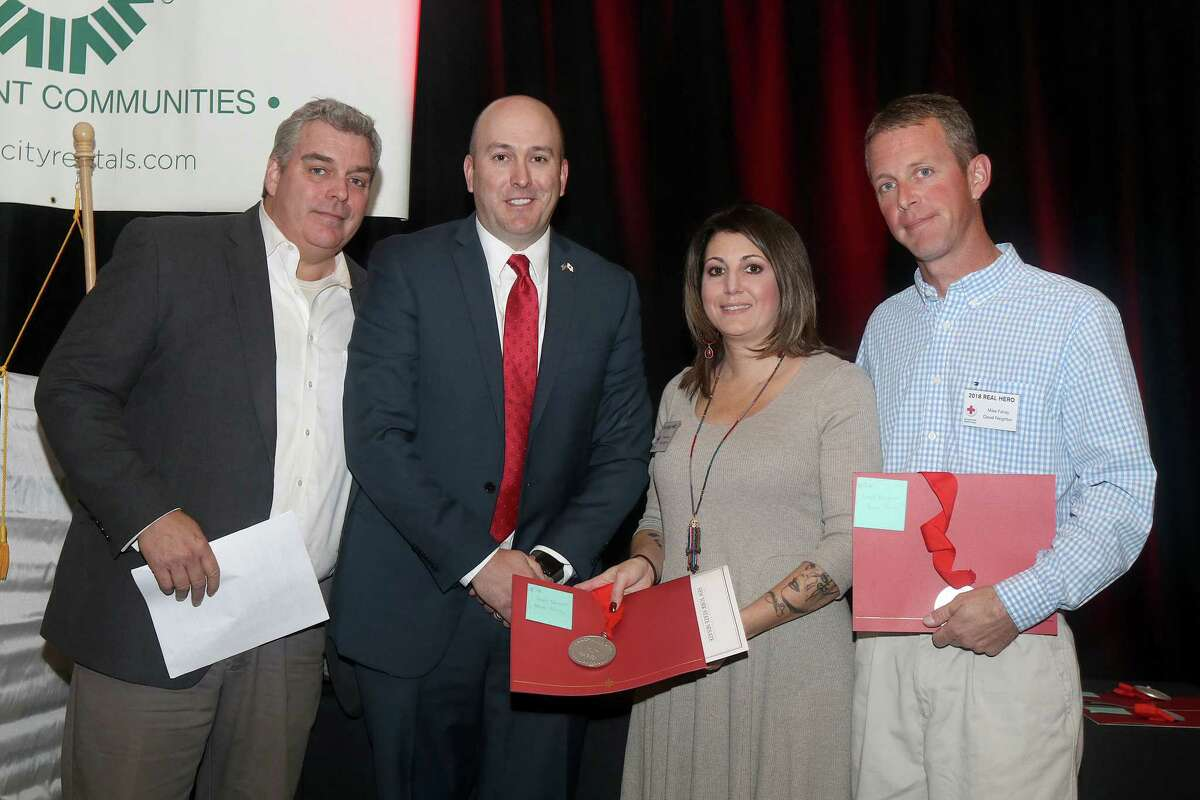 Renee and Mike Fahey, right, founders of Street Soldiers, received a Real Heroes award from the Northeastern New York Chapter of the American Red Cross on Oct. 30, 2018. At left is journalist John Gray and Chief Development Officer Kevin Coffey. (Photo by Joe Putrock)