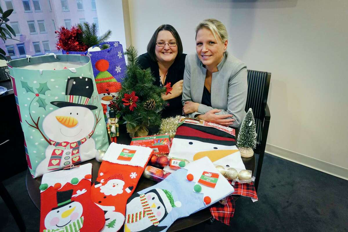 Co-chairs of the upstate New York branch of the Greyson Project, Carrie Dady, left, and Nanette Kelley, sit with some of the donated Christmas decorations, on Wednesday, Oct. 24, 2018, in Albany, N.Y. The project organizes the donations of Christmas decorations that are then used to decorate the hospital rooms of children who cannot be home for Christmas. (Paul Buckowski/Times Union)