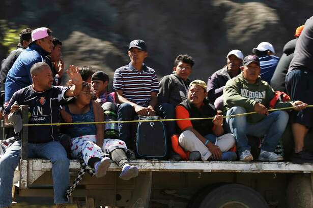 Central American migrants moving as a caravan toward the U.S. border get a free ride on a truck from Guadalajara, Mexico, Tuesday, Nov. 13, 2018. Many say they are fleeing rampant poverty, gang violence and political instability primarily in the Central American countries of Honduras, Guatemala, El Salvador and Nicaragua.