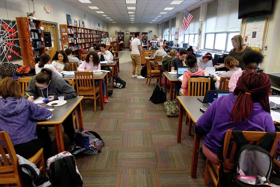 Troy High School students take part in the academic tutoring session for students in the Capital Region Sponsor a Scholar program on Thursday, Oct. 25, 2018, in Troy, N.Y. (Paul Buckowski/Times Union)