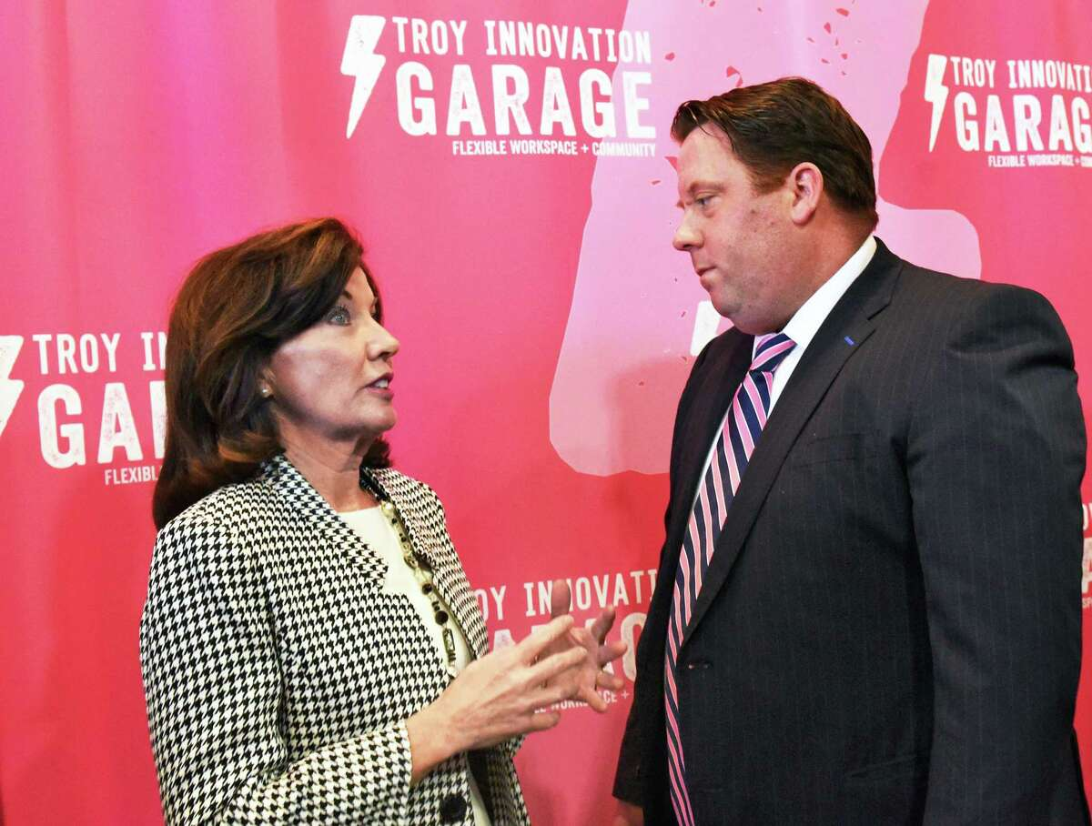 Lt. Gov. Kathy Hochul, left, and Gramercy Communications owner Tom Nardacci speak during grand opening ceremonies for the Troy Innovation Garage, a co-working facility Tuesday March 7, 2017 in Troy, NY. (John Carl D'Annibale / Times Union)