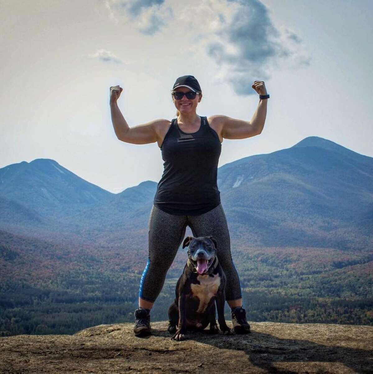 Alicia Boughton, of Rotterdam, at the top of Mt. Van Hoevenberg in the Adirondacks with her dog, Spartacus, in 2017.