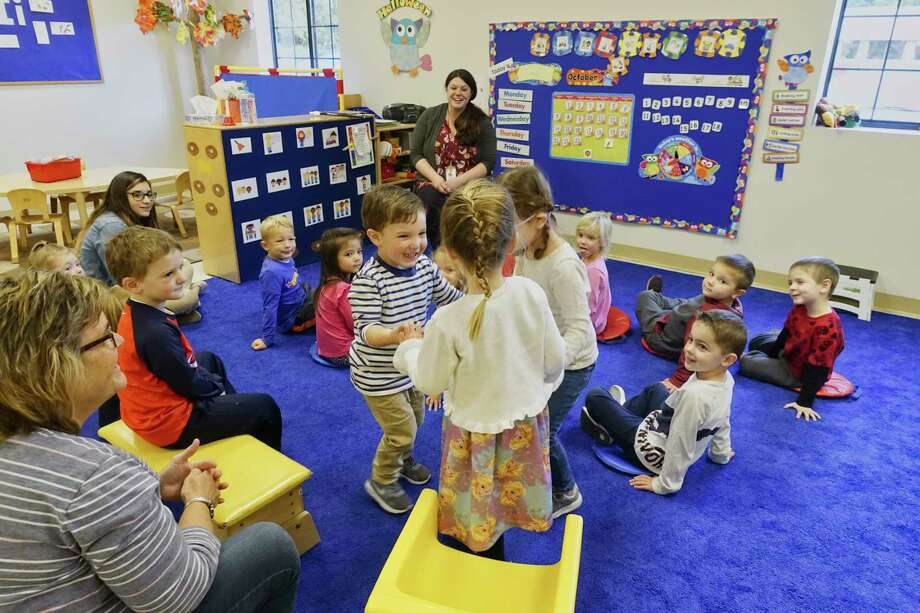 Children And Teachers Take Part In Circle Time At Helping Hands School On Wednesday Oct