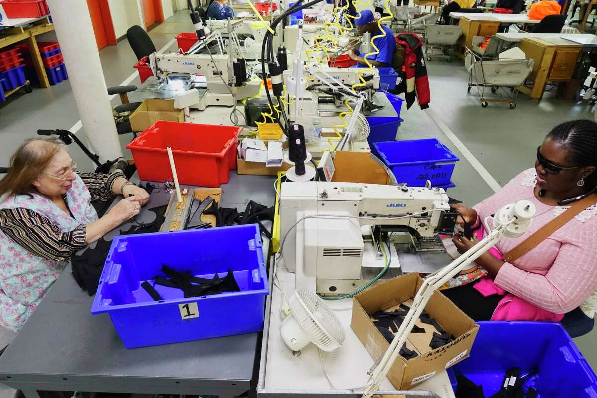 Northeastern Association of the Blind at Albany employees, Jelssomina Greco, left, and Djammila Erkouma, right, work on the manufacturing floor on Tuesday, Oct. 23, 2018, in Albany, N.Y. (Paul Buckowski/Times Union)