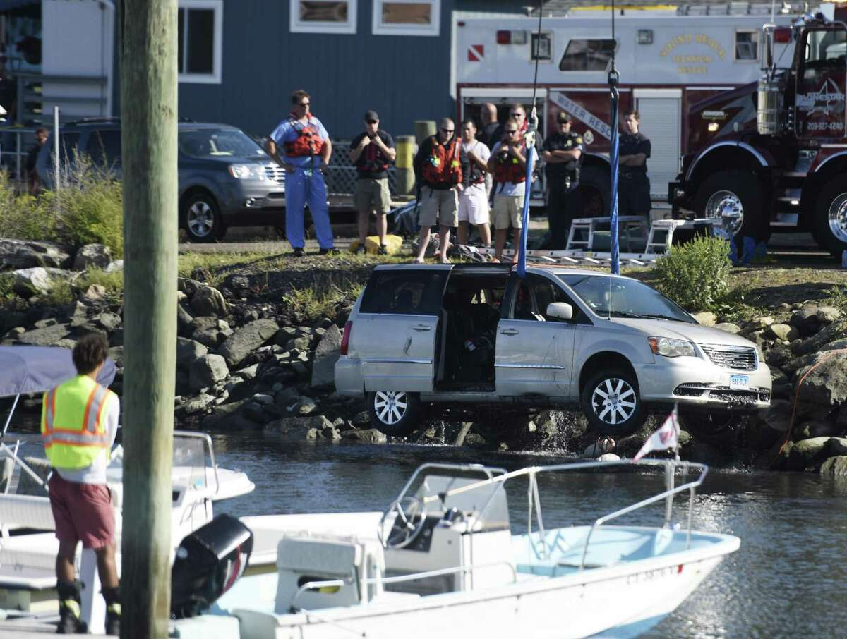 Crews pull a capsized vehicle from Cos Cob Marina in the Cos Cob section of Greenwich, Conn. Monday, Sept. 14, 2015. A New York man in his 80s died after his car fell into the harbor at the marina. Greenwich EMS, fire and police were called to attempt a water rescue, but the man was pronounced dead at the scene.