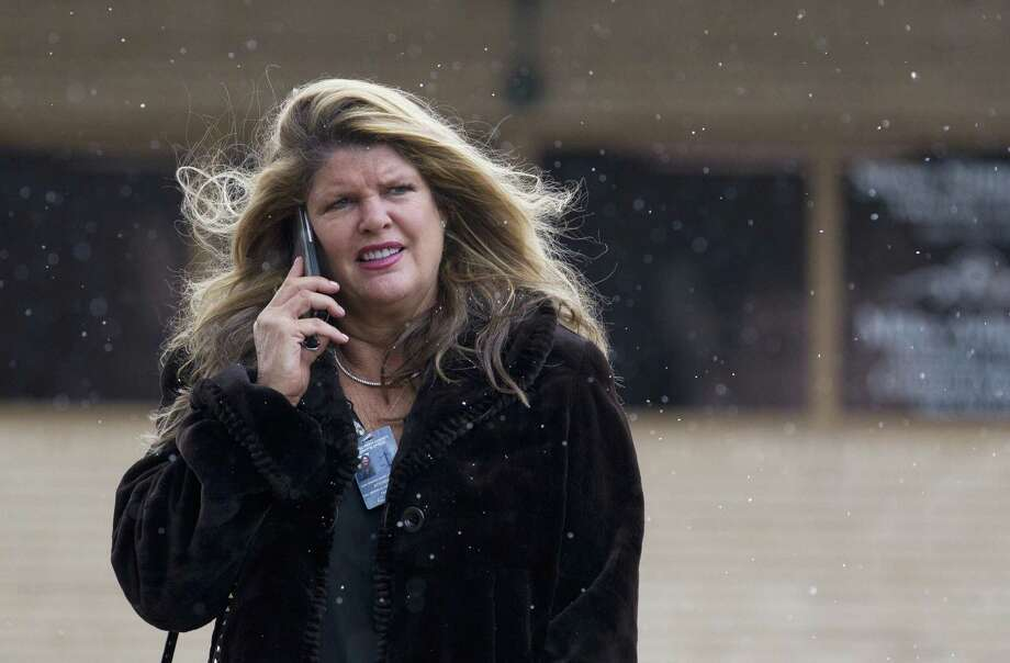 Attorney Mary Van Orman watches as wintery mix falls around her as she walks toward the Montgomery County Courthouse, Tuesday, Nov. 13, 2018, in downtown Conroe. Photo: Jason Fochtman, Houston Chronicle / Staff Photographer / © 2018 Houston Chronicle