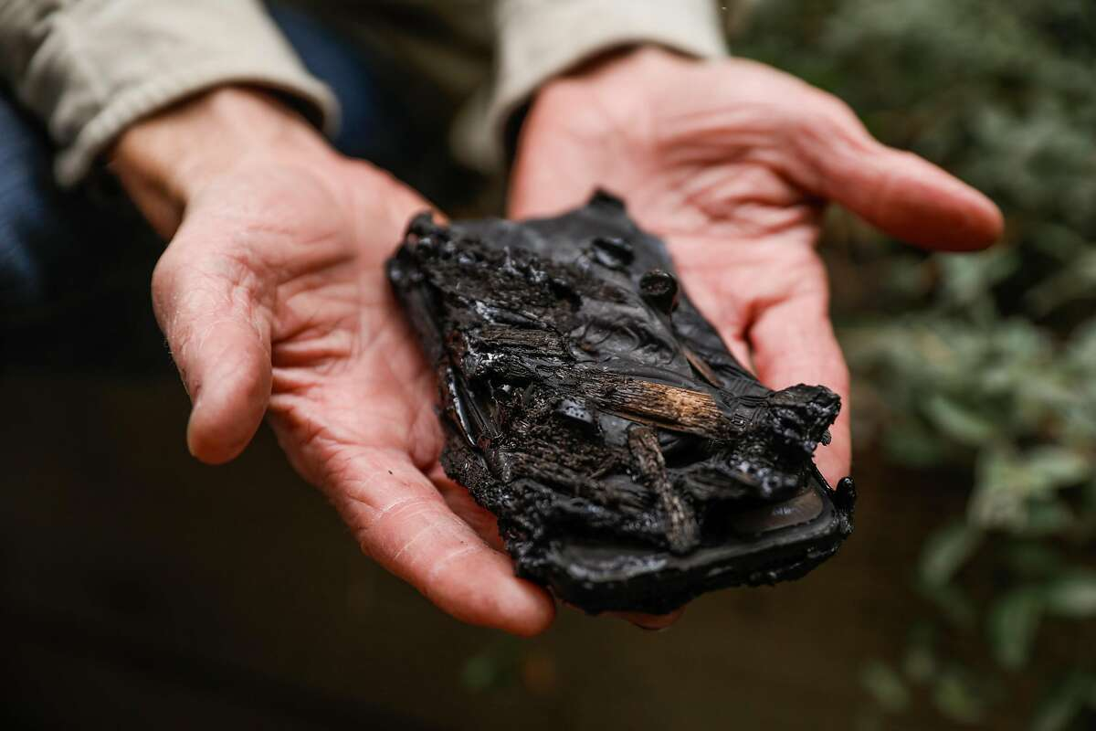 Scott's shows his melted phone in Concow, California, on Tuesday, Nov. 13, 2018. Scott (declined last name) and his family and animals fled into the nearby reservoir as the fire raged through their neighborhood. They were also able to save their 90-year-old neighbor by putting him in a boat and bringing him to shore on the other side.
