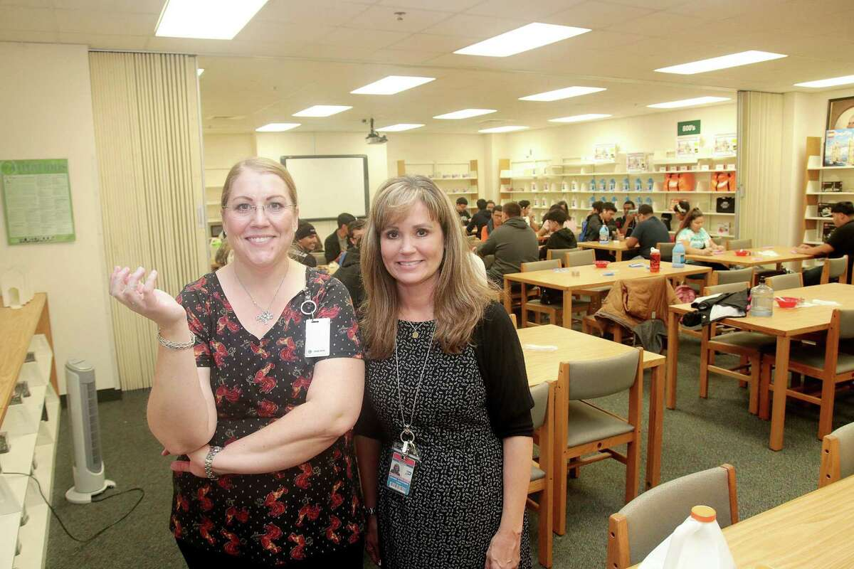 Pasadena High School librarians Emily Dabney, left, and Bonnie Alexander are using a variety of approaches to get kids interested in reading and the library, including a collection of games with oversized pieces that were obtained through a grant.