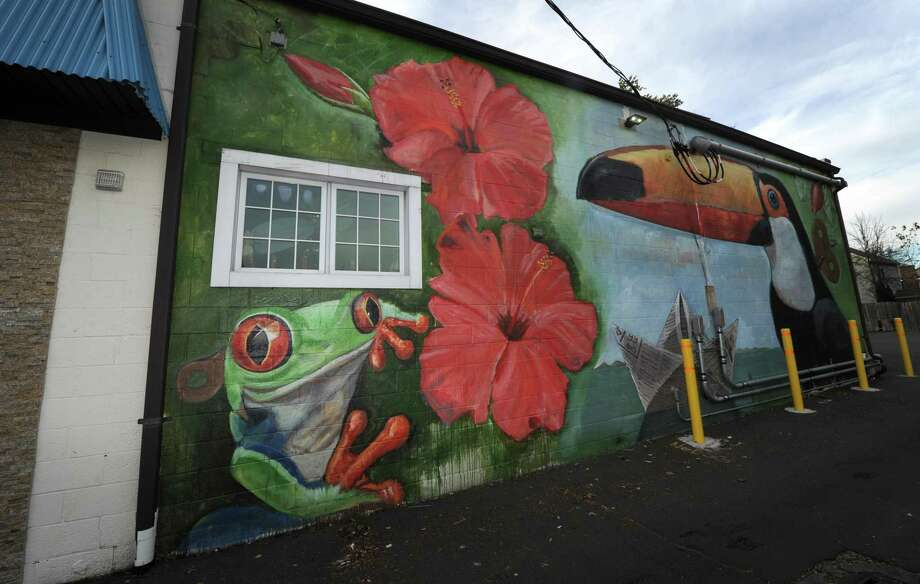 A mural painted on the side of the building that house Valencia restuarant on Main Street Friday, October 19, 2018, in Norwalk, Conn. The Wall Street Neighborhood Association, to which commercial real-estate developer Jason Milligan belongs, has launched an online petition titled 'Save the Wall Art on Wall Street' at change.org. The launch comes after Milligan recently had a mural painted on his property at 97 Wall St. and remains under a zoning violation for the mural he had painted on his building at 21 Isaacs St. Milligan, who remains the subject of a lawsuit after purchasing those and other properties within the stalled Wall Street Place development area, Photo: Erik Trautmann / Hearst Connecticut Media / Norwalk Hour