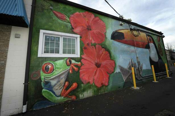A mural painted on the side of the building that house Valencia restuarant on Main Street Friday, October 19, 2018, in Norwalk, Conn. The Wall Street Neighborhood Association, to which commercial real-estate developer Jason Milligan belongs, has launched an online petition titled ?'Save the Wall Art on Wall Street?' at change.org. The launch comes after Milligan recently had a mural painted on his property at 97 Wall St. and remains under a zoning violation for the mural he had painted on his building at 21 Isaacs St. Milligan, who remains the subject of a lawsuit after purchasing those and other properties within the stalled Wall Street Place development area,