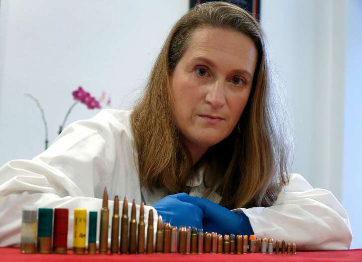 """Pathologist Dr. Judy Melinek displays a variety of shotgun shells and bullets which she uses for educational purposes at her office in San Francisco, Calif. on Tuesday, Nov. 13, 2018. Dr. Melinek's response to an NRA comment that doctors should """"stay in their lane"""" regarding gun violence went viral after she tweeted it on Friday."""