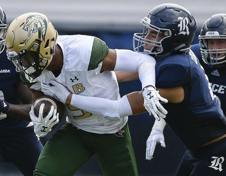 UAB running back Jarrion Street, left, is tackled by Rice defensive back Prudy Calderon during the second half of an NCAA college football game, Saturday, Oct. 13, 2018, in Houston. (Eric Christian Smith/Contributor)