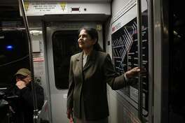 Sonali Bose, SFMTA Director of Finance and Information Technology, rides a MUNI streetcar to have her portrait taken on Tuesday, November 13, 2018 in San Francisco, Calif.