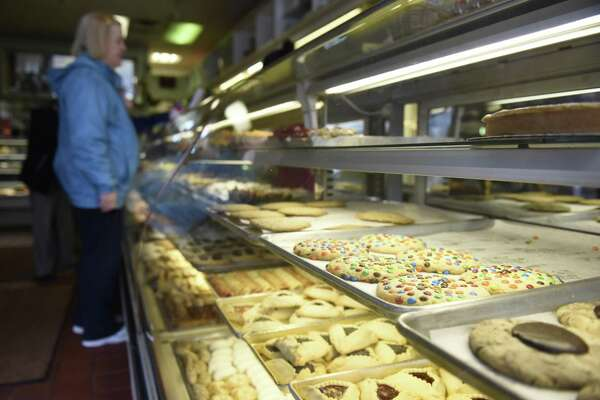 Customers browse tasty pastries at DiMare Pastry Shop in the Riverside section of Greenwich, Conn. Tuesday, Nov. 13, 2018. DiMare is closing the doors for its shop in the Riverside Commons shopping center when its lease is up in early January, but will remain open at 12 Largo Dr. in Stamford.