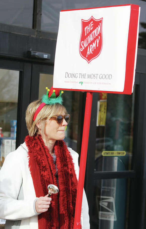 Angie Holtkamp volunteers as a Salvation Army bell-ringer last year at the Godfrey Schnucks store. The annual kettle campaign begins Nov. 23 and continues through Dec. 24. Photo: Scott Cousins | The Telegraph
