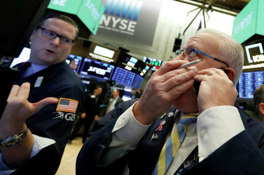 FILE- In this Friday, Nov. 9, 2018, file photo trader Thomas Ferrigno, right, and specialist Gregg Maloney work on the floor of the New York Stock Exchange. The U.S. stock market opens at 9:30 a.m. EDT on Tuesday, Nov. 13. (AP Photo/Richard Drew, File) Photo: Richard Drew / Copyright 2018 The Associated Press. All rights reserved