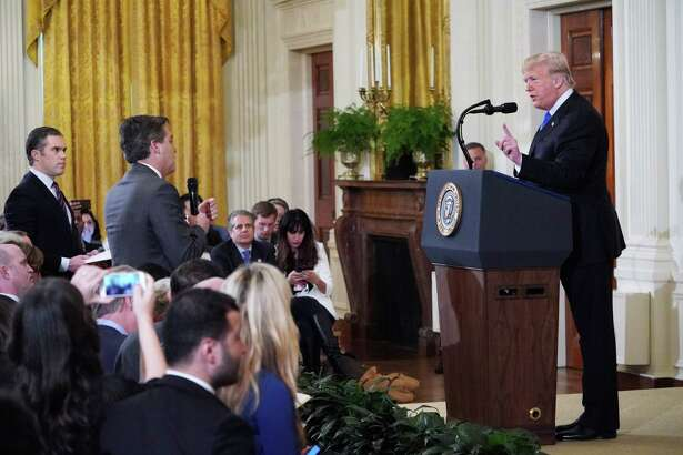 President Donald Trump gets into a heated exchange with CNN chief White House correspondent Jim Acosta in the East Room of the White House on Nov. 7. Acosta had his press credentials pulled as a result.