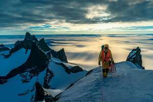 "Climber Conrad Anker hikes along a ridge in Antarctica during filming of ""Queen Maud Land."""