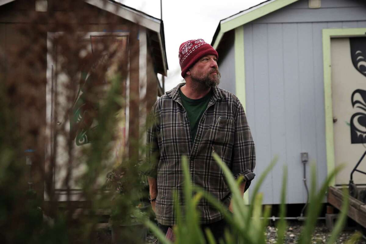 Robert Bowen walks through the Nickelsville Georgetown tiny house village where he has lived with his wife Ashley for the past few months. Robert believes an influx of affordable housing will help quell the ongoing homelessness crisis in Seattle.