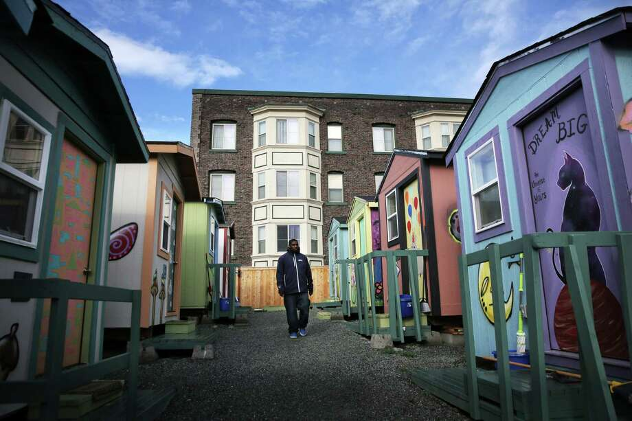 Kenyatta Webb walks through the True Hope Village on East Yesler Way where he has lived with his 14-year-old son, Milchia, for the past two months, Oct. 28, 2018. Photo: GENNA MARTIN, SEATTLEPI.COM / SEATTLEPI.COM