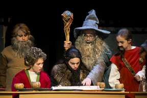 "Bailey Bills in the role of Bilbo Baggins, left, Jacob Alexander in the role of Thorin Oakenshield, center, Caden Cummings in the role of Gandalf the Gray, top, and Kassidy Manley in the role of Dwalin, right, act out a scene during a dress rehearsal for the Peanut Gallery's production of ""The Hobbit"" on Monday, Nov. 12, 2018 at the Midland Center for the Arts. (Katy Kildee/kkildee@mdn.net)"