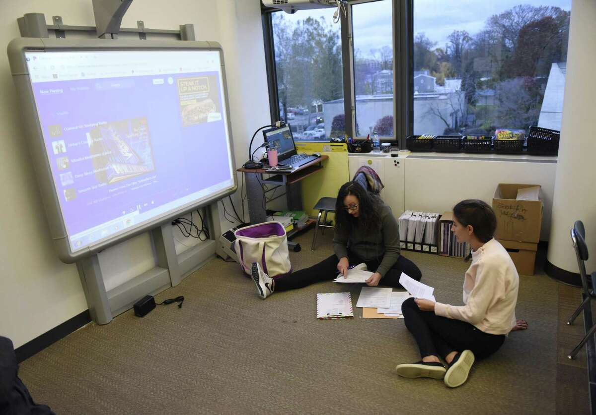 Second-grade teachers Jessica Buckett, left, and Lexie Radonich prepare for class at he new Westover Magnet Elementary School, dubbed Westover @ 1 Elmcroft, in the Harbor Point neighborhood of Stamford, Conn. Tuesday, Nov. 13, 2018. Students were required to relocate after a severe mold problem was found in the school, so kids will now attend school in an office building with certain floors repurposed to suit students' learning needs.