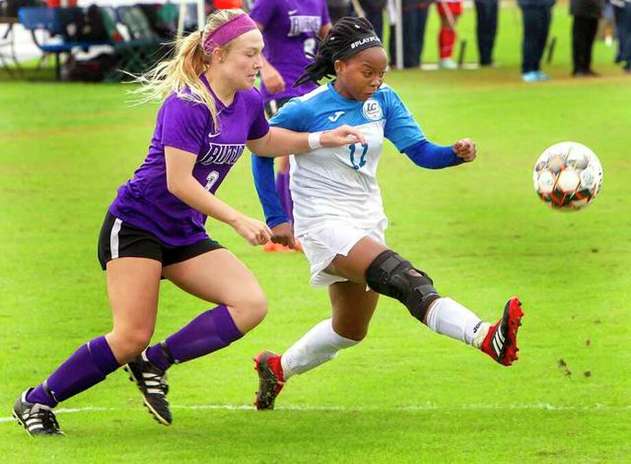 LCCC's Senate Letsie (11) controls the ball against Kaylee Swanson of Butler Community College Tuesday at the NJCAA National Tournament in Foley, Ala. Letsie scored the game-winning goal in overtime, in her team's 3-2 victory. Photo: Jan Dona | For The Telegraph
