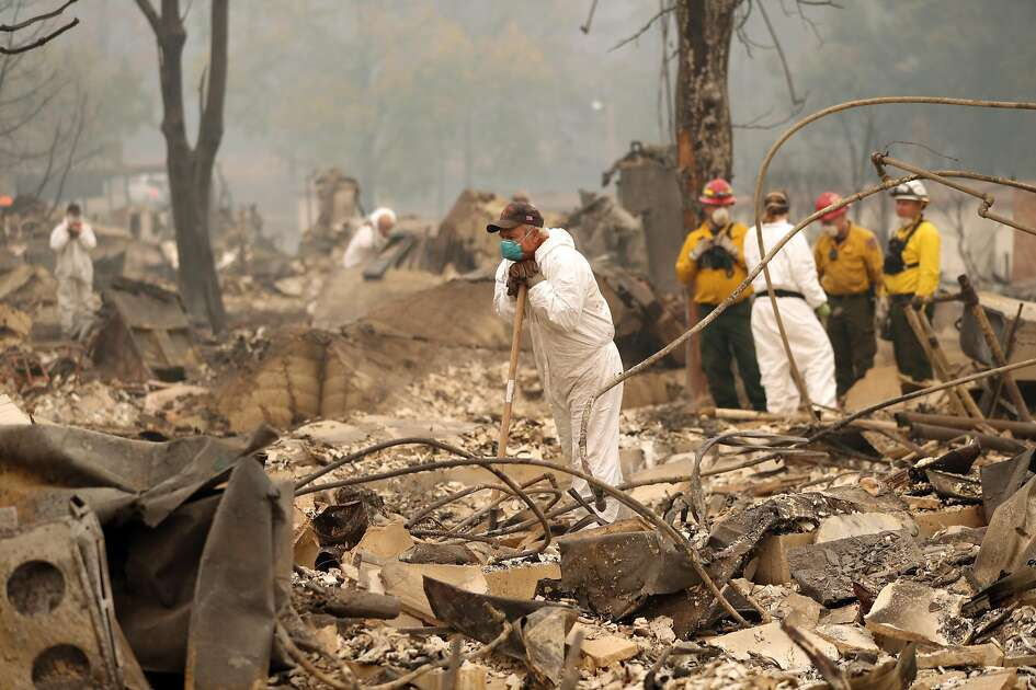Fire personnel search for fire victims in the rubble of the Shelter Cove Apartments in aftermath of Camp Fire in Paradise, Calif. on Tuesday, November 13, 2018.