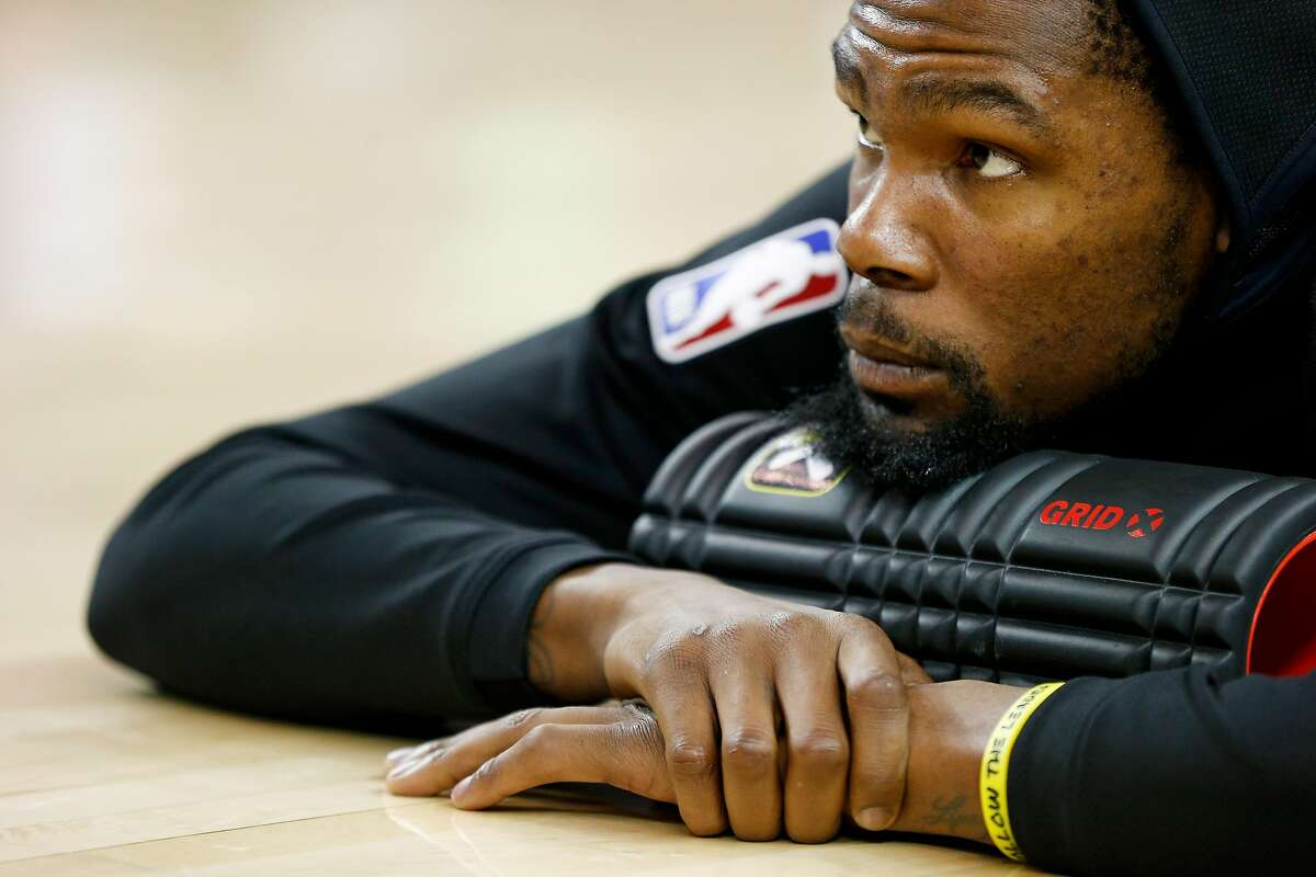 Golden State Warriors forward Kevin Durant (35) stretches before an NBA game against the Brooklyn Nets at Oracle Arena on Saturday, Nov. 10, 2018, in Oakland, Calif.