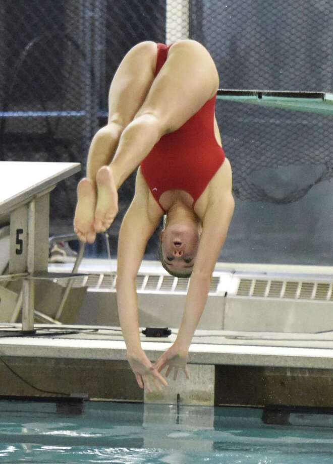 Greenwich senior Maddie Muldoon won the Class LL diving championship last week with 476.15 points. Photo: Tyler Sizemore / Hearst Connecticut Media / Greenwich Time