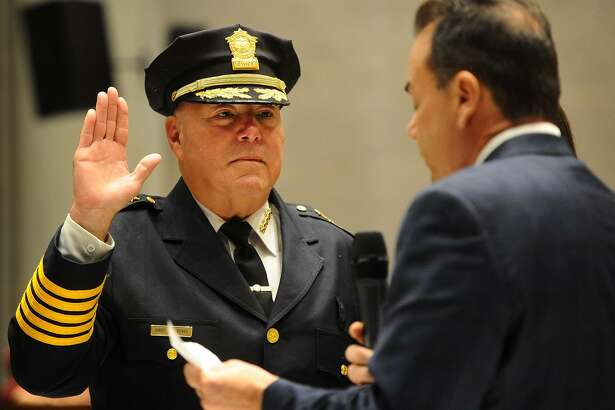 Armando Perez is sworn in as Bridgeport police chief by Mayor Joseph Ganim at City Hall in Bridgeport on Tuesday.